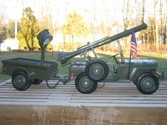 1965 gi joe jeep battery powered searchlight and jeep sounds with a missile launcher I have this jeep it is so dam cool