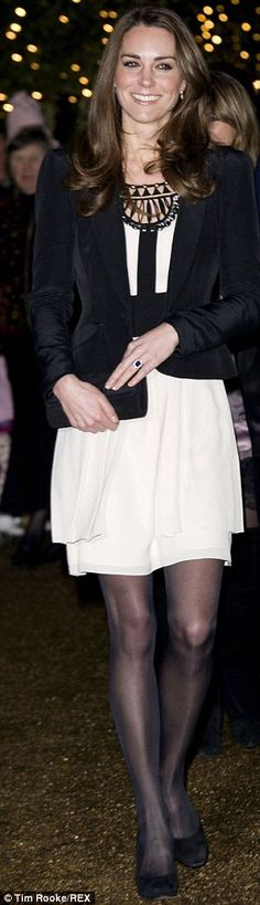 Kate Middleton paired a tiered silk Temperley London dress with a blazer and black heels to attend the Christmas Spectacular in London with Prince William by her side, December 17, 2010.