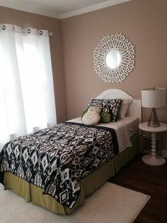 """For the kid's room, I wanted the space to be gender-neutral, and youthful but not overly """"kiddie"""".  So I went with a navy/lime/taupe/white color palette, which is fresh and fun without being over the top."""