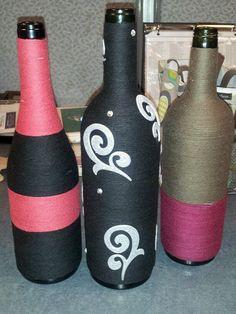wine bottles wrapped in yarn. super easy!