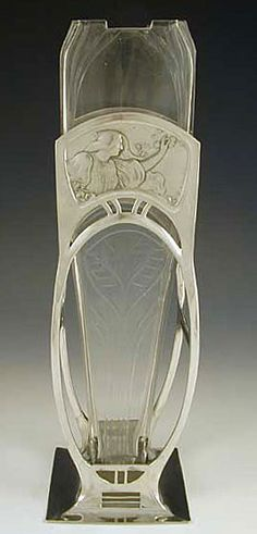 Polished pewter vase with typical art nouveau figural maiden decoration and original glass liner circa 1906