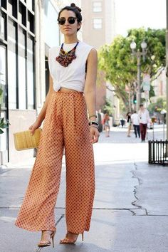 High waisted palazzo pants, tied t-shirt and statement necklace