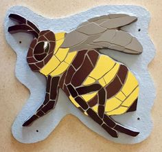 The mosaic bee is finished! Perfect for gardens patios schools nurseries community centres and basically any wall that needs him! This mosaic is the first of a new insect collection I am making and it would be great if you could let anyone know who you think might be interested in them. This chap is spoken for but I am now taking orders for whatever insect/animal you may like! Coming up I have made you a little film so you can take a closer look! Thanks for all your support Fx