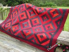 summer in the park quilt in gray and reds.