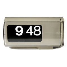 Made in 1966 The Cifra 3 is a clock designed by Italian architect Gino Valle (1923–2003) in 1965 and is widely considered a masterpiece of industrial design. It uses a Split-flap display to show both hours and minutes. Available at protowares.com