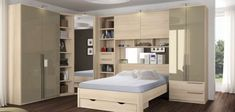 Camere da letto matrimoniali a ponte - Armadio in legno chiaro_ bello anche il cassetto sotto al letto