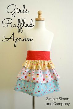 Girls Ruffled Apron Tutorial | Simple Simon and Company/  Here's the link:  http://www.simplesimonandco.com/2013/08/girls-ruffled-apron-tutorial.html