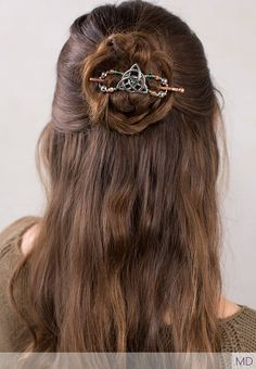 Half up bun hairstyle featuring gorgeous triquetra design in silver and copper with bright green- Trinitee Flexi Clip from Lilla Rose
