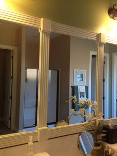 using trim to frame bathroom mirror