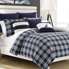 Over-sized for a convenient and generous fit, the Eddington Duvet Cover easily fits over existing comforters with a simple button closure. Crafted with soft cotton, this Nautica sham and duvet cover set is decorated in a traditional blue plaid motif.