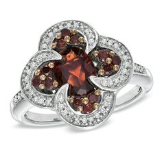 Oval Garnet and 1/3 CT. T.W. Enhanced Red and White Diamond Ring in Sterling Silver - Size 7
