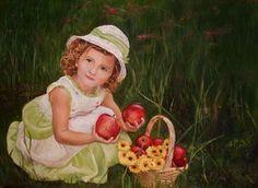 Kislány almákkal