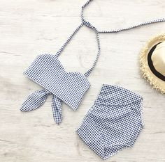 Beautiful Clara gingham set of shorts and matching crop top is perfect for summer vacations, the beach, and summer parties. The design was created by me and exclusive only to Miss Lyla! Adjustable back waist tie Top & short set Unlined Lightweight gingham material tie halter crop top