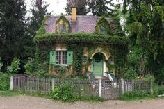 The last tiny house is a fairytale cottage. Ok, one more to see. A cabin just beyond in the woods.......