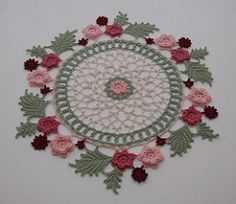 This is one of my favorites that I did for the book Annie's Attic Book Irish Beauty Doilies Which is a book of my designs. This to me is a true Irish Beauty full of the Irish Roses and Picots. I did this one in size 10 threads.