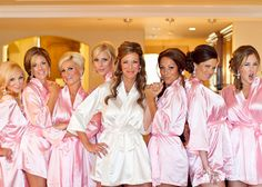 Matching silk pink robes for the bridesmaids and white robe for the bride. #cute