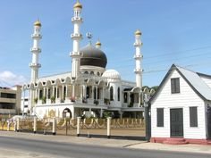 This beautiful mosque sits right beside the oldest synagogue in the Americas. Beautiful Mosques, Place Of Worship, South America, Taj Mahal, Most Beautiful, Old Things, Guyana, Building, Places
