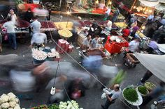 Reza Golchin captures the blur and movement of buyers and sellers at fresh fruit and fish bazaars in contemporary Iran. © Reza Golchin http://lenscultu.re/zv580P