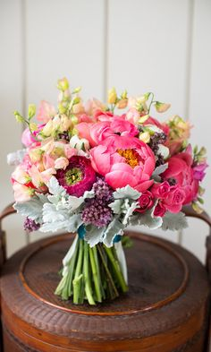 I love the soft peachy yellow sweet pea flowers peaking out the top and the large messy pink bulbs and the dusty grey leaves. It looks like a coral reef - something from natures bounty.