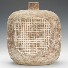 """Claude Conover (American, 1907-1994) 16 x 13 x 8 in. """"Morelos"""". Hand built ceramic vessel with cross hatched and striped impressed pattern with clay slip rubbed into surface with matte finish, grid pattern on side. Signed and titled underneath."""