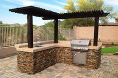 Specially designed pergola cuts the sun's glare on this built in grill. Glendale, AZ natural stone grill island and paver patio with outdoor fire pit by Desert Crest. Backyard Kitchen, Outdoor Kitchen Design, Backyard Patio, Patio Wall, Flagstone Patio, Kitchen Grill, Kitchen Bars, Outdoor Kitchens, Grill Area