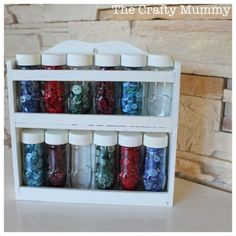 spice rack converted to button rack. Am thinking beads, sequins, buttons etc