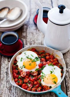 Baked Eggs on a Bed of Cherry Tomatoes by yummysupper via amazine #Eggs #Tomatoes #Healthy