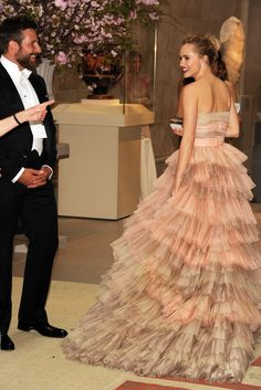 6:28 p.m.: Aerin Lauder opens Bradley Cooper's jacket to inspect his white tie. Suki Waterhouse, Bradley's girlfriend, arrives. I'm busy fiddling with my iPhone and miss the shot of them kissing hello. I do get a few of them together though. [Photo by Steve Eichner]