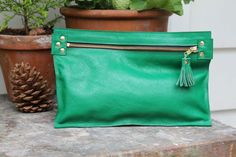 Hey, I found this really awesome Etsy listing at http://www.etsy.com/listing/113921789/zip-clutch-in-emerald-green