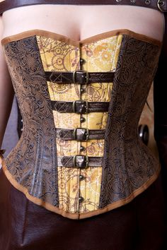 Steampunk Tooled Faux Leather Midbust  Riding Corset. $369.00, via Etsy.
