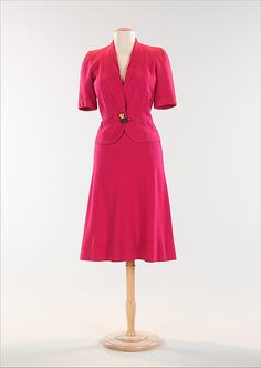 Elsa Schiaparelli | Suit, 1938-39. The colour of this suit, Schiaparelli's signature Shocking pink, was dubbed thus because it represented her desire to shock those around her with her unique and sometimes avant-garde designs. Her goal was to design clothing and accessories that possessed an artistic aesthetic, rather than the more conventional idea of fashion and beauty.