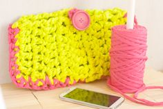 Try this T-shirt yarn clutch in Lion Brand Fettucini. Pattern Tutorial by Make and Takes.