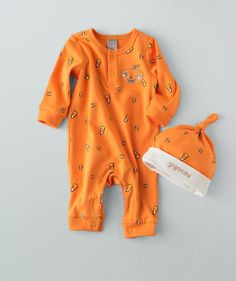 This matched baby Halloween set is sweet as candy corn and is bright and lively…