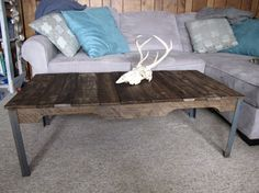 Pallet Coffee Table with Steel Legs  - Hand Made from reclaimed wood and pallets - Stained as in pictures - Available with different colored paint wash - Available with out paint wash - Sturdy - Rough textured with out splintering - 16 inches tall with all dimensions unless asked otherwise *Shipping* Etsy can not calculate shipping there for shipping cost are calculated from Ohio to California. Once your order is placed, If the price of shipping is less than amount paid already I will…