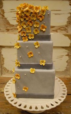 3 tier square gray cake with yellow flowers - Via http://cakepicturegallery.com/v/birthday-cakes/3+tier+square+gray+cake+with+yellow+flowers.JPG.html