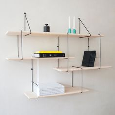 Shelving: Berlin-based label Studio Hausen designed a minimal shelving unit made of steel mounting brackets and wooden boards that can be customized to cater to an individual's needs and environment.