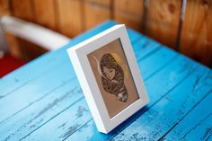 This is a limited edition art product from Unposted Letters. The thick boxed-type mini-frame has a simple wooden texture, which gives the product a unique look.