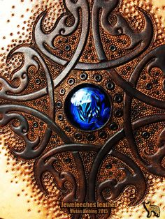 >>> Detail of my handmade leather handbag of natural tanned leather by Jeweleeches Vivian Hebing! Of course with my own handmade glass cabochon it, made of silverglass! It's my own design, so please do not copy! Do you want to see more of my work, you can find me on facebook or Etsy too!