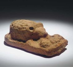 Roman Egyptian terracotta hedgehog with three young, 1st-2nd century A.D.   Of Nile clay, the hedgehog facing three young, feeding with their noses together, on integral base, 10.8 cm long. Private collection