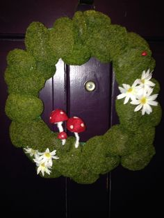 faux moss stone wreath with felt mushrooms, daisies and a ladybug....  working on a better picture! sold at my etsy store