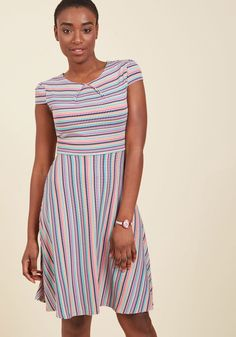 The Jersey Is Out A-Line Dress  You have yet to decide if you'll don this jersey knit dress for your vacation's debut day or to add enjoyment to your return back home. Considering the cap sleeves, pleat-accented neckline, and teal, black, magenta, and orange square pattern of this comfy A-line, you land on rocking the look for both!
