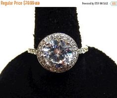 Storewide 25% Off SALE Vintage Sterling Silver Round Brilliant Cut Ladies Engagement Ring Featuring Baguette Accented Design Finish by ClevelandFinds on Etsy
