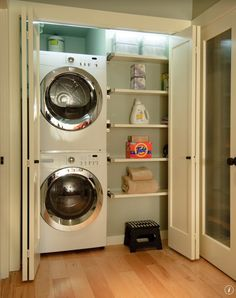 could be cute with the clouded windows on the door. like an old fashion laundry mat look functional laundry closet - stackable.   (also accordion doors)