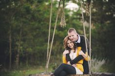 Vibrant North Carolina engagement photos by Crystal Stokes Photography. Love the rustic swing and Terra's yellow sweater. Pretty!