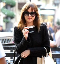 Dakota Johnson steps out with new, brunette hair.