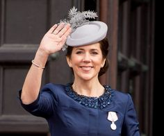 Crown Princess Mary's grey hat was adorned with felt feathers.