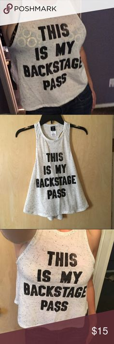 This is my backstage pass halter neck tank Fun and sexy little white w/black speckles tank. It's sort of cropped, but hangs loose so I tried to show how it covers but as u move you can see your stomach. ☺️ Tops Tank Tops