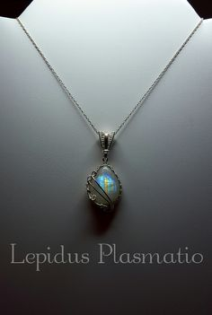 Sterling silver wire wrapped rainbow moonstone pendant by Lepidus Plasmatio