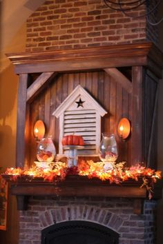 Fall decor for mantel. Fall magazines are in those vases!