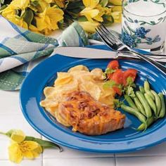 """Au Gratin Taters N Chops Recipe -""""This easy entree will please adults and children alike,"""" promises Laura Starkey of Manhattan, Kansas. """"I made it often as a college student, decreasing the number chops to two so I would have great-tasting leftovers for lunch or dinner the next day."""""""